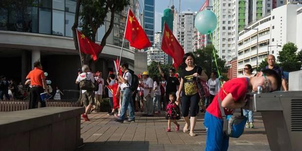 Hong Kong: quand des contre-manifestants crient leur amour pour la Chine - La Libre