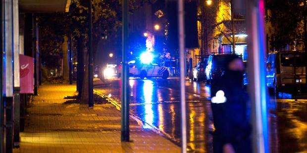 Attentats de Paris: Un photographe agressé lors des perquisitions à Molenbeek - La Libre