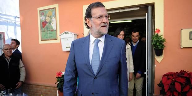 Rajoy promet des baisses d'impôts en cas de victoire aux législatives - La Libre