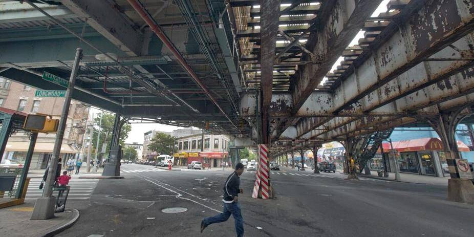 """A young man runs under an elevated section of subway tracks in The Bronx borough of New York, Wednesday, May 22, 2013. A company that offered tourist treks to the Bronx """"ghetto"""" has shut down under scathing criticism from neighborhood leaders offended by the tours that took mostly European and Australian tourists past food-pantry lines and """"pickpocket"""" park. But other New York companies continue to show visitors, many of them foreigners who know of the Bronx only from movies, the grittiest part of the city's poorest borough. (AP Photo/Richard Drew) Associated Press / Reporters"""
