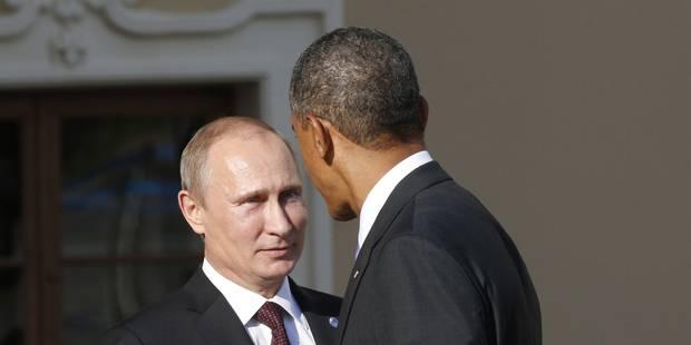 Poignée de mains et sourires forcés entre Poutine et Obama au G20 - La Libre