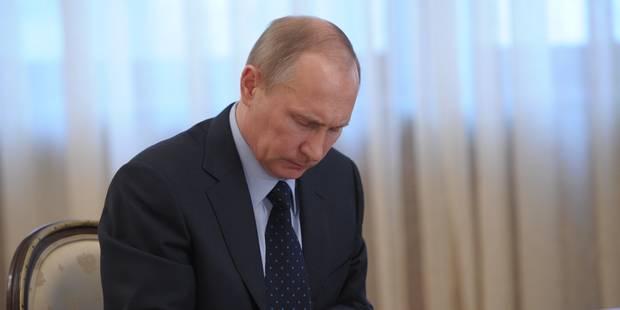 Poutine signe le traité intégrant la Crimée à la Russie - La Libre