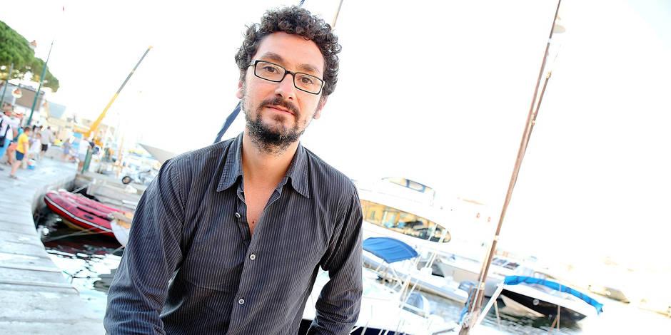"""David Foenkinos - La litterature s'invite sur le port de St Tropez ou plusieurs ecrivains ont dedicace leurs ouvrages à l'initiative d'une manifestation intitulée"""" Les Nocturnes Litteraires"""", le 11 aout 2013. Reporters / Bpresse"""