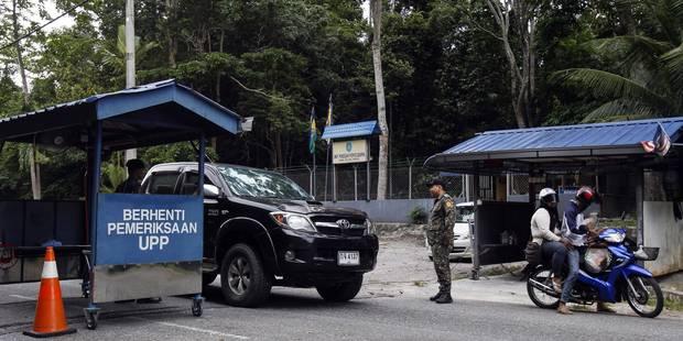 La Malaisie découvre une trentaine de fosses communes renfermant des migrants - La Libre