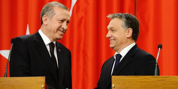 Turkish Prime Minister Recep Tayyip Erdogan, left, and his Hungarian counterpart Viktor Orban shake hands at the end of their joint press conference in the Parliament building in Budapest, Hungary, Tuesday, Feb. 5, 2013. (AP Photo/MTI, Tamas Kovacs)