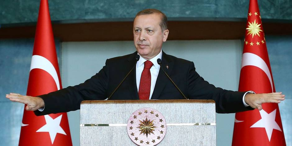 """A handout picture taken and released by Turkish presidential press office on January 12, 2016 shows Turkish President Recep Tayyip Erdogan delivering a speech during the Ambassador's Conference at the Presidential Complex in Ankara. Turkish President Recep Tayyip Erdogan said today's attack on Istanbul's tourist heart that killed 10 people and wounded 15 was carried out by a suicide bomber of Syrian origin and foreigners were among the dead. / AFP / TURKISH PRESIDENTIAL PRESS OFFICE / KAYHAN OZER / RESTRICTED TO EDITORIAL USE - MANDATORY CREDIT """"AFP PHOTO /TURKSIH PRESIDENTIAL PRESS OFFICE /KAYHAN OZER"""" - NO MARKETING NO ADVERTISING CAMPAIGNS - DISTRIBUTED AS A SERVICE TO CLIENTS"""