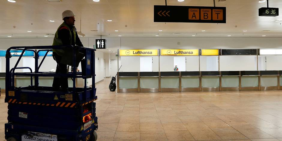 A worker stands on a lift in the departures hall at Zaventem Airport in Brussels on Friday, April 22, 2016. Construction is ongoing to repair the departures hall after a set of deadly blasts killed and injured scores on March 22, 2016. (Francois Lenoir/Pool Photo via AP)