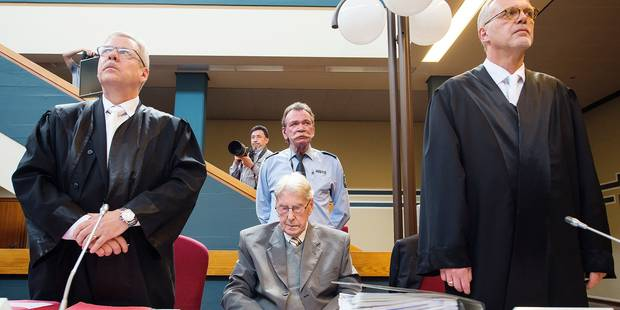 94-year-old former SS sergeant Reinhold Hanning who served as a guard at Auschwitz sits between his lawyers Andreas Scharmer, left, and Johannes Salmen, right, in the courtroom in Detmold, Friday, June 17, 2016. He has been found guilty of more than 170,000 counts of accessory to murder on allegations he helped the Nazi death camp kill 1.1 million Jews and others. Henning was sentenced to five years in prison. (Bernd Thissen/Pool Photo via AP)