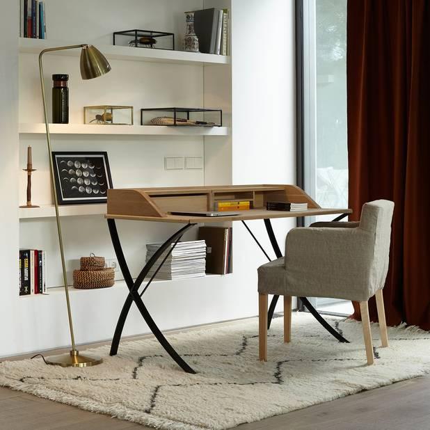 On ressort les rideaux épais pour isoler la pièce.  Rideau lainage La Redoute, à partir de 69,99 €.