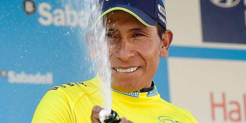 """Movistar's Colombian cyclist Nairo Quintana celebrates on the podium after winning the 68th edition of """"Volta Ciclista a la Comunidad Valenciana"""" (Tour of Valencian Community), after the fifth stage, a 130.2 km run between Paterna and Valencia on February 05, 2017. / AFP PHOTO / JOSE JORDAN"""