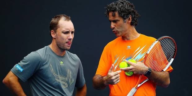 Yannis Demeroutis (R) pictured with Steve Darcis (ATP 80) during a training practice at the 'Australian Open' tennis Grand Slam, Sunday 15 January 2017 in Melbourne Park, Melbourne, Australia. This first grand slam of the season takes place from 16 to 29 January. BELGA PHOTO PATRICK HAMILTON