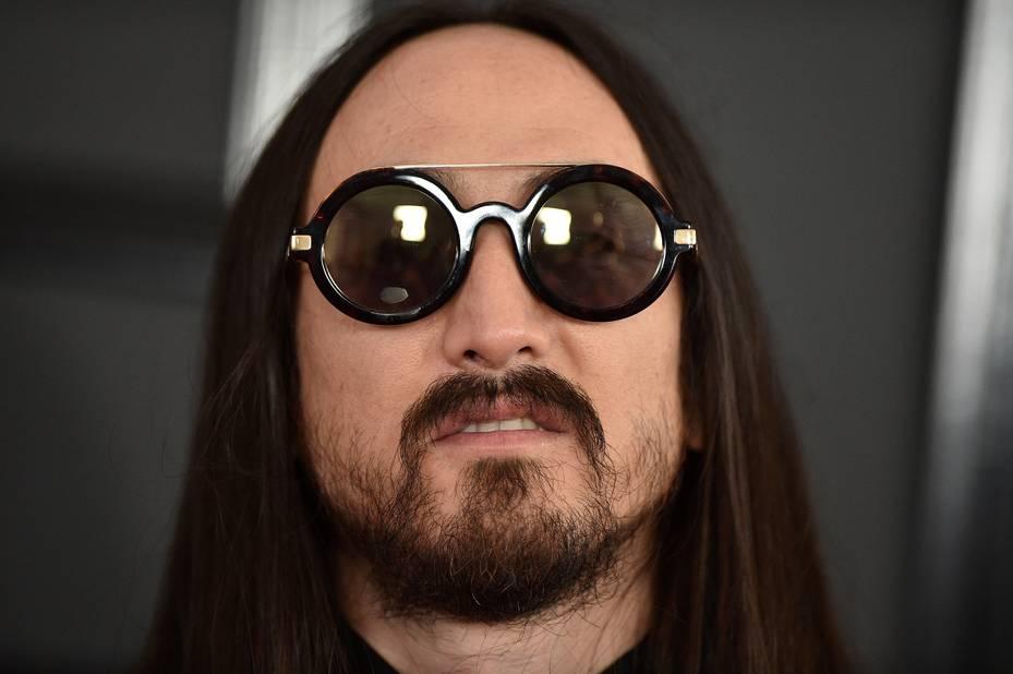 Il n'aurait pas copié le look d'un certain John Lennon ??