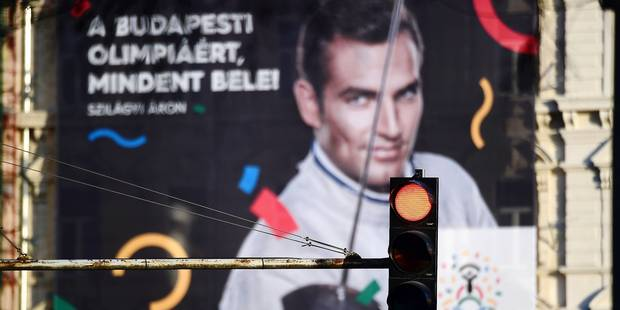 This picture taken on January 17, 2017 in Budapest shows a poster of Hungarian Olympic winner of sabre in Rio de Janeiro 2016 and London 2012, Aron Szilagyi, advertising Budapest's bid to host the 2024 Olympic Games . Budapest's bid to host the 2024 Olympic Games faces a new referendum challenge after a youth group critical of Prime Minister Viktor Orban said they will begin collecting signatures this week. / AFP PHOTO / ATTILA KISBENEDEK