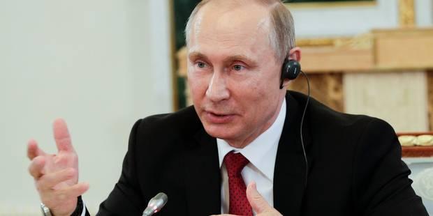 """Nouvelles sanctions: Poutine promet une réponse à l'""""insolence"""" américaine - La Libre"""