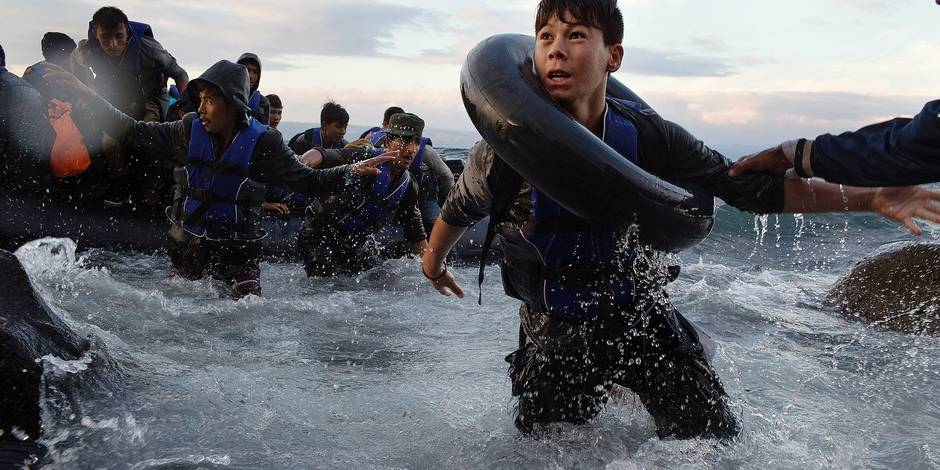 After battling rough seas and high winds on the crossing from Turkey, migrants arrive on the northern shore of Lesbos Island in Greece.