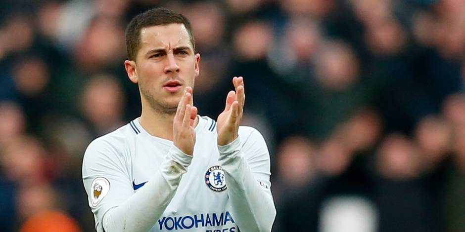 Chelsea's Belgian midfielder Eden Hazard applauds supporters on the pitch after the English Premier League football match between West Ham United and Chelsea at The London Stadium, in east London on December 9, 2017. West Ham won the game 1-0. / AFP PHOTO / Ian KINGTON / RESTRICTED TO EDITORIAL USE. No use with unauthorized audio, video, data, fixture lists, club/league logos or 'live' services. Online in-match use limited to 75 images, no video emulation. No use in betting, games or single club/league/player publications. /