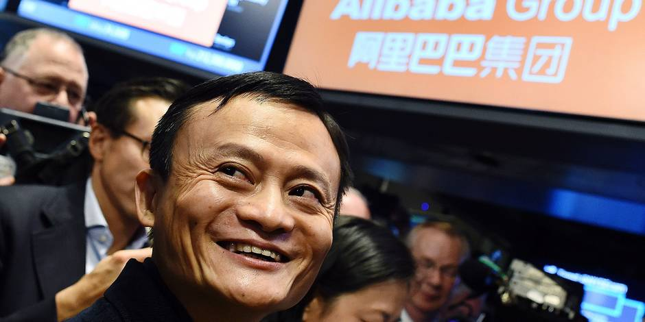 """TO GO WITH AFP STORY by Luc Olinga, US-stocks-technology-online-Alibaba (FILES) Chinese online retail giant Alibaba founder Jack Ma smiles as he waits for the trading to open on the floor at the New York Stock Exchange in New York in this September 19, 2014, file photo. Wall Street in 2014 enjoyed its best year for initial public offerings since 2000, thanks to the record-setting flotation of Chinese Internet giant Alibaba and a barrage of biotech deals. Activity was """"uninterrupted"""" and proved largely immune to forces that at times rattled equity markets, Renaissance Capital said in a report this week. AFP PHOTO/JEWEL SAMAD/FILES"""