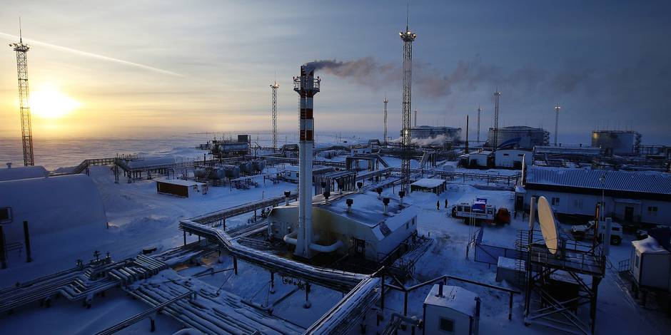 "Picture taken on February 18, 2015 shows facilities of Novoprtovskoye oil and gas condensates oilfield of Russian gas and oil giant Gazprom at Cape Kamenny in the Gulf of Ob shore line in the south-east of a peninsular in the Yamalo-Nenets Autonomous District, 250 km north of the town of Nadym, northern Russia. For the first time ""Gazprom Neft"" company implemented winter shipment of oil by sea from Novoportovskoye deposit located on the Yamal Peninsula. The first batch of raw materials in the amount of 16 thousand tons was sent to European consumers by two tankers accompanied by an icebreaker. AFP PHOTO / ANDREY GOLOVANOV / AFP PHOTO / ANDREY GOLOVANOV"