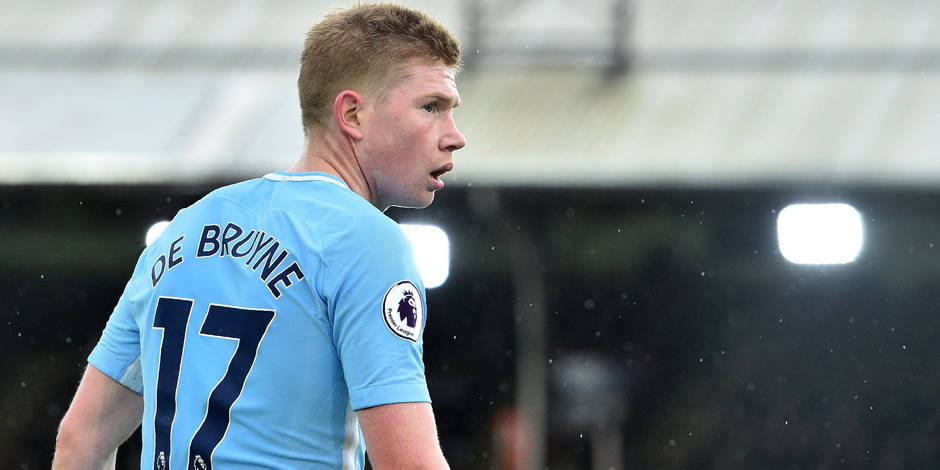 (FILES) This file photo taken on December 31, 2017 shows Manchester City's Belgian midfielder Kevin De Bruyne in the rain during the English Premier League football match between Crystal Palace and Manchester City at Selhurst Park in south London. The Belgian international midfielder Kevin De Bruyne has extended his contract with Manchester City until 2023, the leading club in the Premier League announced on Monday, January 22, 2018. / AFP PHOTO / Glyn KIRK / RESTRICTED TO EDITORIAL USE. No use with unauthorized audio, video, data, fixture lists, club/league logos or 'live' services. Online in-match use limited to 75 images, no video emulation. No use in betting, games or single club/league/player publications. /