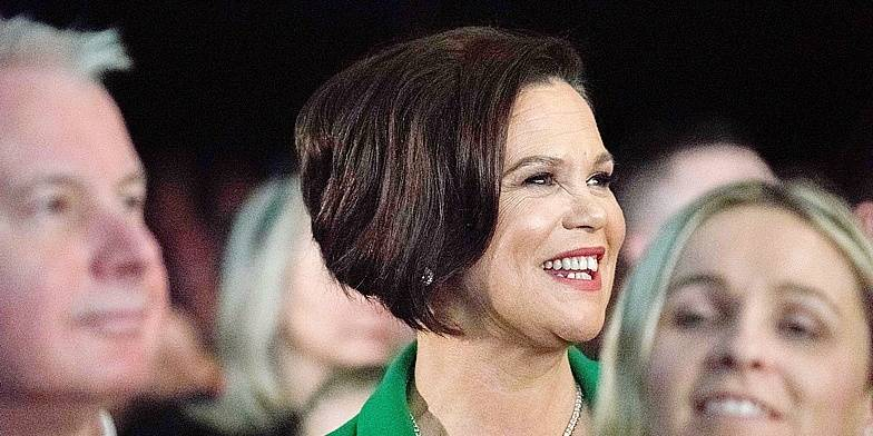 New Sinn Fein president Mary Lou McDonald (C) attends a special Sinn Fein party conference to confirm her as the new president of the Irish republican party in Dublin on February 10, 2018. Mary Lou McDonald officially replaces on February 10, 2018 Gerry Adams as the president of Sinn Fein following his decision to step down after 34 years as the figurehead of the Irish republican movement. / AFP PHOTO / Barry CRONIN