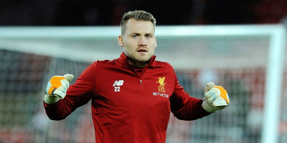 Liverpool's Simon Mignolet warms up before the English Premier League soccer match between Liverpool and Chelsea at Anfield, Liverpool, England, Saturday, Nov. 25, 2017. (AP Photo/Rui Vieira)