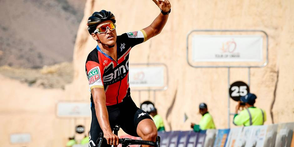 UCI WorldTeam BMC Racing Team's Belgian rider Greg Van Avermaet crosses the finish line to win the 3rd stage of the cycling Tour of Oman between the German University of Technology and Wadi Dayqah Dam near Qurayyat on February 15, 2018. / AFP PHOTO / Philippe LOPEZ