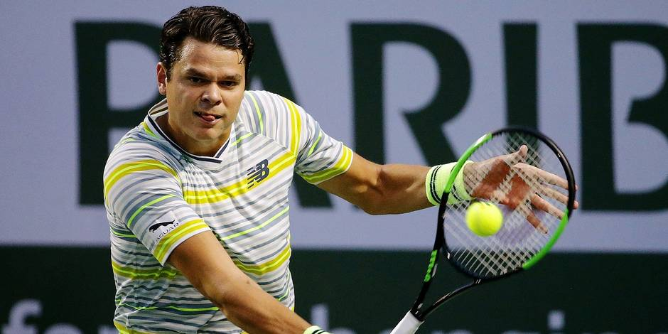 INDIAN WELLS, CA - MARCH 11: Milos Raonic of Canada returns a backhand to Felix Auger Aliassime of Canada during the BNP Paribas Open on March 11, 2018 at the Indian Wells Tennis Garden in Indian Wells, California. Jeff Gross/Getty Images/AFP == FOR NEWSPAPERS, INTERNET, TELCOS & TELEVISION USE ONLY ==
