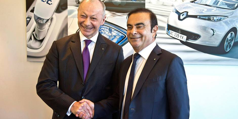 French car maker Renault CEO Carlos Ghosn, right, and his new deputy Thierry Bollore pose for photographers after the presentation of the company 2017 at the headquarters in Boulogne-Billancourt, outside Paris, Friday Feb. 16, 2018. French carmaker Renault says it had record profit and sales last year, boosting its shares and CEO Carlos Ghosn's bid to keep his job. (AP Photo/Michel Euler)
