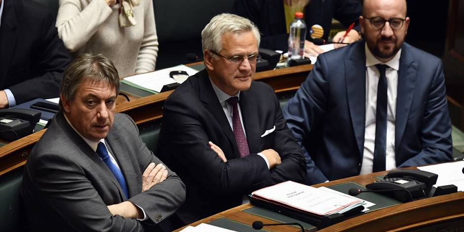 Vice-Prime Minister and Interior Minister Jan Jambon, Vice-Prime Minister and Minister of Employment, Economy and Consumer Affairs Kris Peeters and Belgian Prime Minister Charles Michel pictured during a plenary session of the Chamber at the federal parliament, in Brussels, Thursday 05 October 2017. BELGA PHOTO ERIC LALMAND